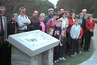 Dr Boucher's family gather round the plaque after its unveiling