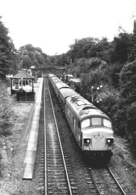 The Down Harwich Boat Train, the 7.2B Harwich Parkeston Quay - Manchester clatters through Marple on 12th August 1979.
