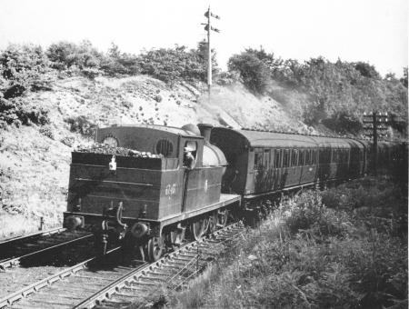 Ex.-G.C. 4-4-2 C13 suburban tank No.67401 brings a Macclesfield-Manchester train round the curve towards Marple wharf Junction in 1956.