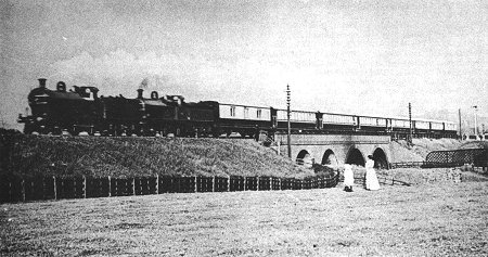 The Royal Train conveying King Edward VII and Queen Alexandra, passing Bredbury Station (extreme right) on 12th July, 1905.