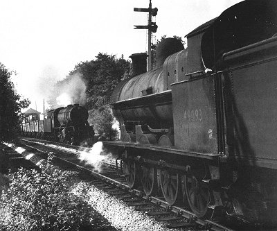 New and old steam locomotives meet at Marple Wharf Junction in August 1956.