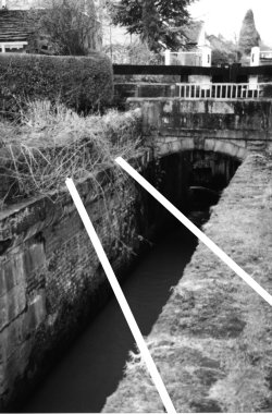 The white lines superimposed on this photograph show where the tramway rails used to cross the canal, just below lock 10 (M.Whittaker)